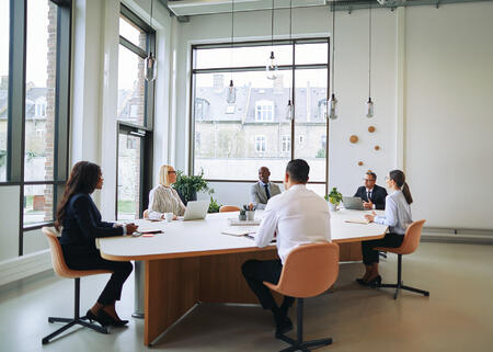 diverse-group-of-smiling-businesspeople-having-a-meeting