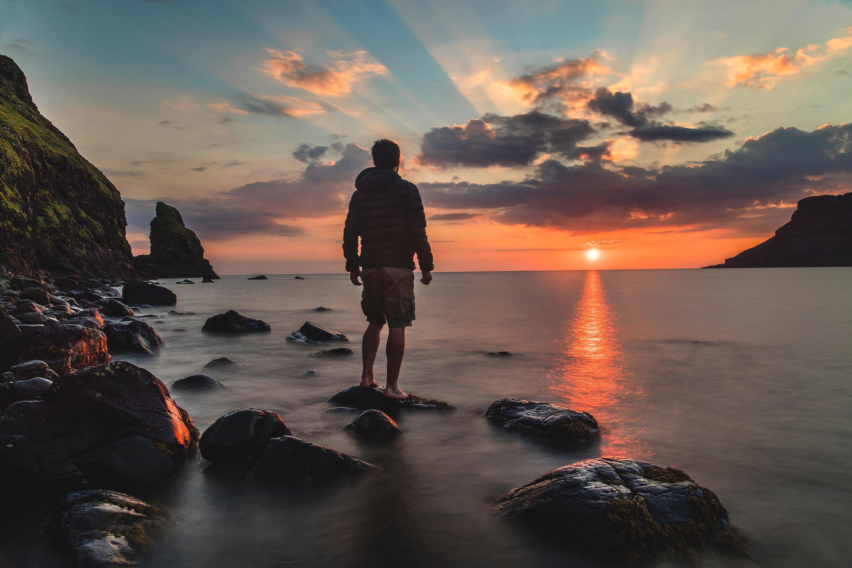 dude standing on rocks