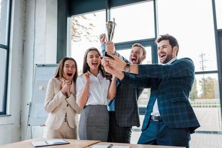 happy-businessmen-and-multicultural-businesswomen