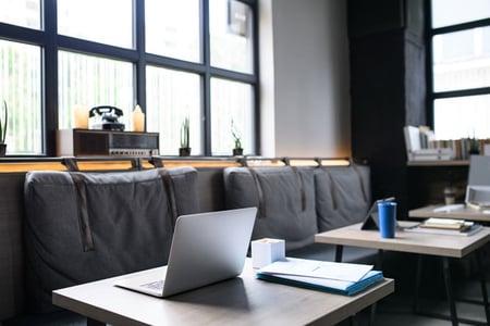 laptops-on-desks-in-empty-modern-office