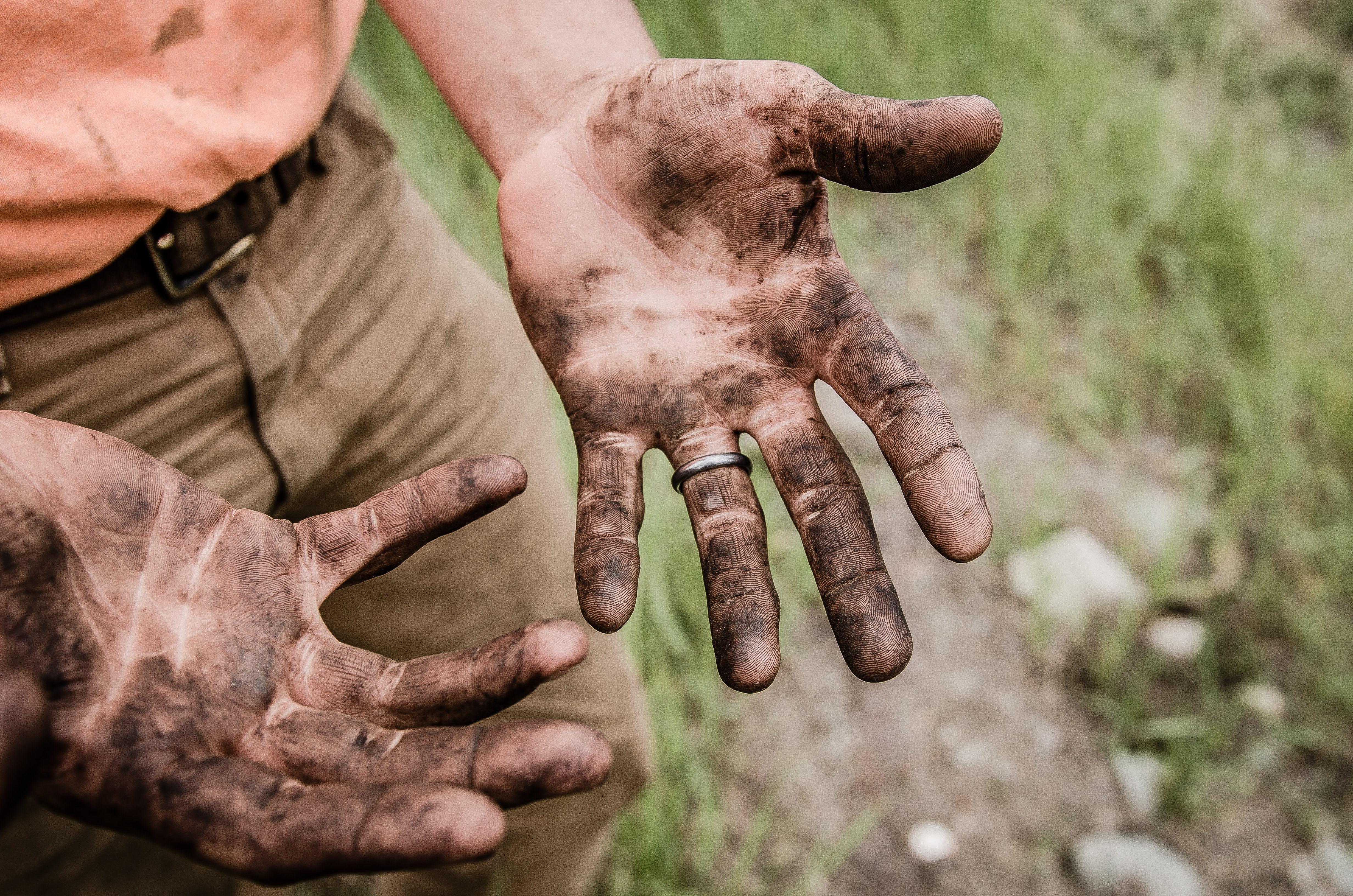 man with muddy hands