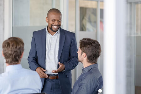 mature-business-man-in-meeting-smiling