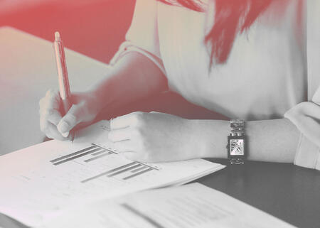 woman-reading-DISC-report-TTI-Success-Insights-1