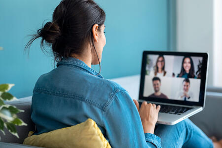 woman-speaking-on-video-call-with-diverse-colleagues